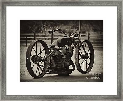 Rusty Rims Framed Print by Wilma  Birdwell