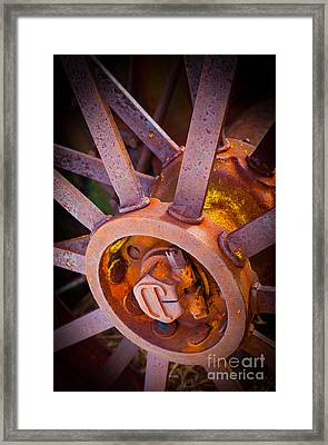 Rusty Spokes Framed Print by Inge Johnsson
