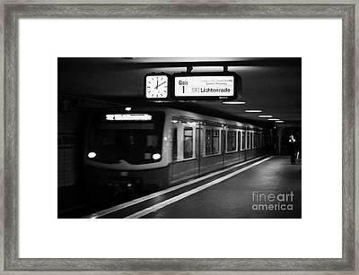 s-bahn train speeding through unter den linden underground station Berlin Germany Framed Print by Joe Fox