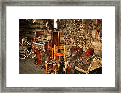 Saddle And Piano Framed Print by Marty Koch