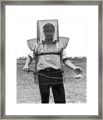 Safety Cage For Caddies Framed Print by Underwood Archives