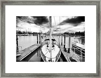 Sailboat Docked Framed Print by John Rizzuto