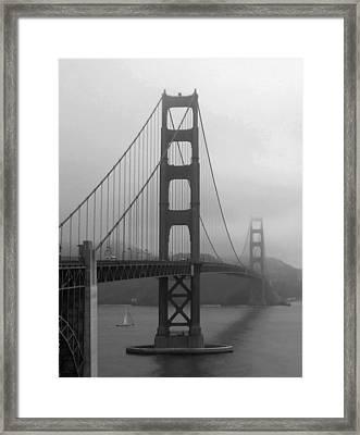 Sailboat Passing Under Golden Gate Bridge Framed Print by Connie Fox
