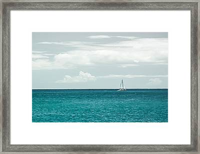 Sailing On A Turquoise Sea Framed Print by Jason Bartimus