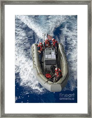 Sailors Conduct Man Overboard Training Framed Print by Stocktrek Images
