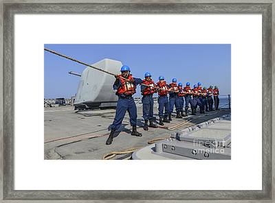 Sailors Heave A Line During A Man Framed Print by Stocktrek Images