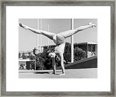 Sally Rand Combines A Hand Stand With The Splits Framed Print by Underwood Archives