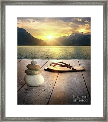 Sandals And Rocks Framed Print by Sandra Cunningham