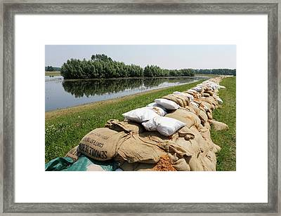 Sandbags On A Dike Framed Print by Michael Szoenyi