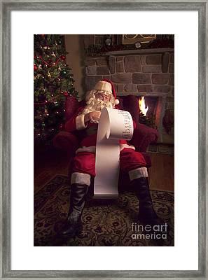 Santa Checking His List Framed Print by Diane Diederich