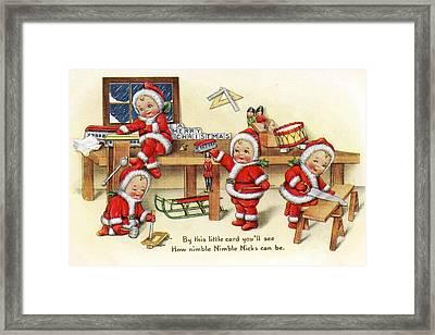 Santa Helpers At Work Framed Print by Munir Alawi