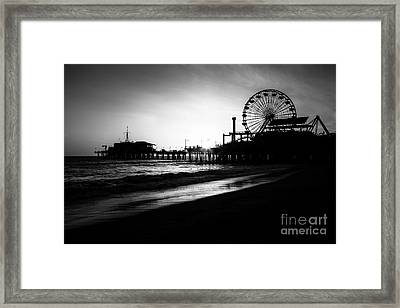 Santa Monica Pier In Black And White Framed Print by Paul Velgos