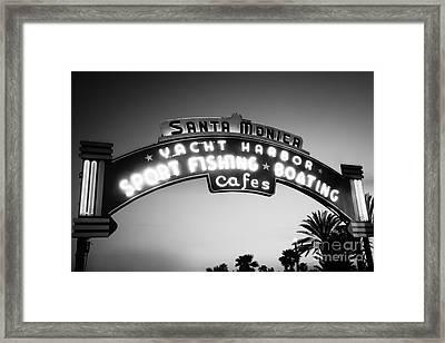 Santa Monica Pier Sign In Black And White Framed Print by Paul Velgos