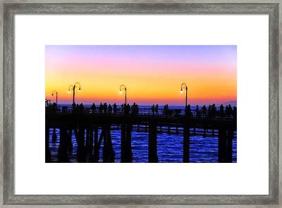 Santa Monica Pier Sunset Silhouettes Framed Print by Lynn Bauer