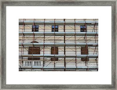 Scaffolding On Building Facade Framed Print by Sami Sarkis