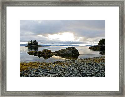 Scenic View Of The The Sun Setting Over Framed Print by Cathy Hart