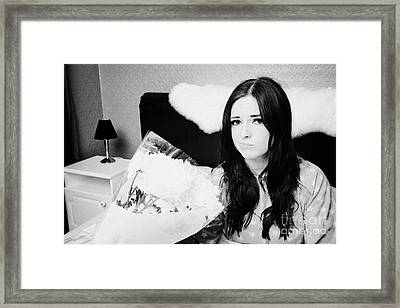 Sceptical Early Twenties Woman With Bunch Of Flowers In Bed In A Bedroom Framed Print by Joe Fox