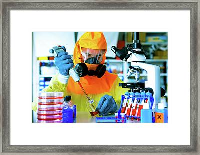 Scientist In Hazmat Suit Framed Print by Wladimir Bulgar