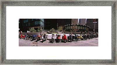 Scooters And Motorcycles Parked Framed Print by Panoramic Images