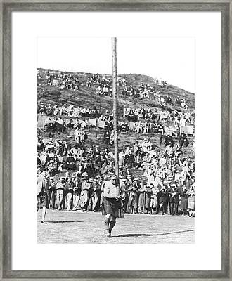 Scotsman Tossing The Caber Framed Print by Underwood Archives
