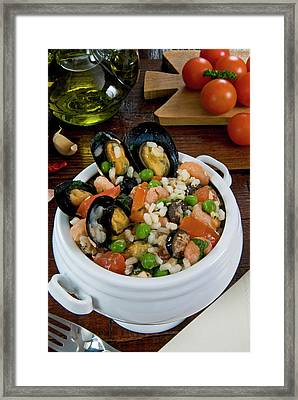 Seafood Rice With Mussels, Shrimps Framed Print by Nico Tondini