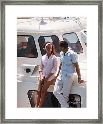 Sean Connery And Claudine Auger On The Disco Volante  Framed Print by The Phillip Harrington Collection
