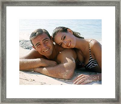 Sean Connery And Claudine Auger  Framed Print by The Phillip Harrington Collection
