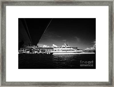 Seaplane Passing Ferry And Dock At Fort Jefferson Dry Tortugas National Park Florida Keys Usa Framed Print by Joe Fox