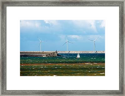 Seascape With A Sailboat And A Wind Farm On Rough Sea Framed Print by Mikel Martinez de Osaba