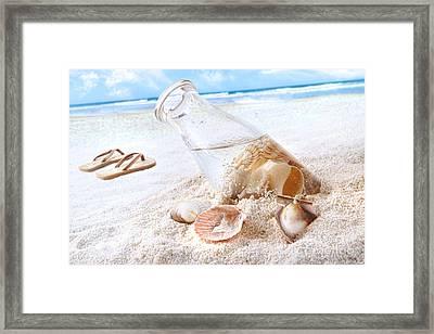 Seashells In A Bottle On The Beach Framed Print by Sandra Cunningham