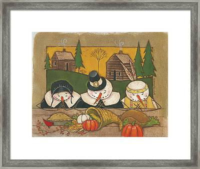 Seasonal Snowman Xi Framed Print by Anne Tavoletti