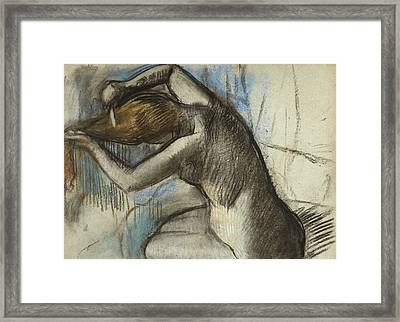 Seated Nude Woman Brushing Her Hair Framed Print by Edgar Degas
