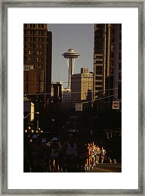 Seattle Marathon With Space Needle Framed Print by Jim Corwin