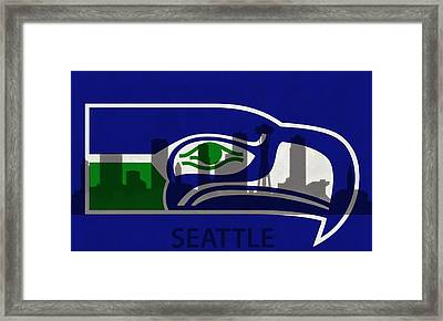 Seattle Seahawks On Seattle Skyline Framed Print by Dan Sproul