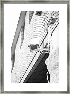 Security Camera Framed Print by Tom Gowanlock