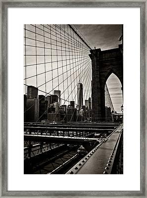 Seen Through The Brooklyn Bridge Framed Print by Madeline Ellis