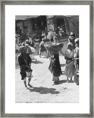 Selling Bread In Baghdad Framed Print by Underwood Archives