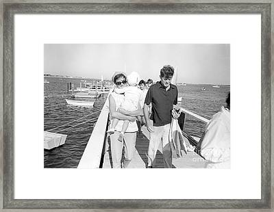 Senator John F. Kennedy And Jacqueline Kennedy At Hyannis Port Marina Framed Print by The Phillip Harrington Collection