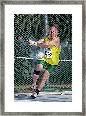 Senior Athlete Prepares Hammer Throw Framed Print by Alex Rotas