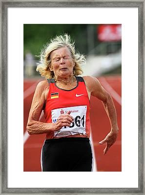 Senior Athlete Runs Through The Pain Framed Print by Alex Rotas