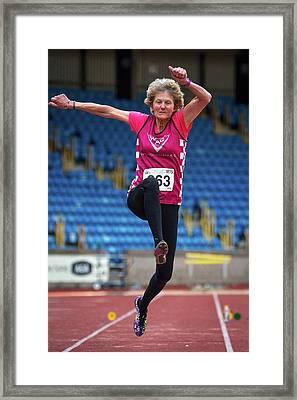 Senior British Female Athlete Mid-air Framed Print by Alex Rotas