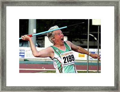 Senior Female Athlete Throws Javelin Framed Print by Alex Rotas