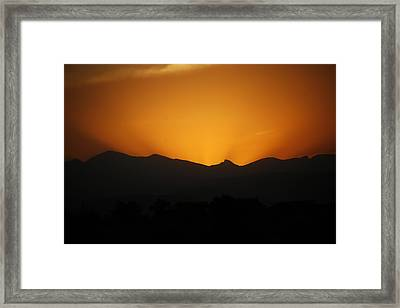 Serious Sunset Framed Print by Marilyn Hunt