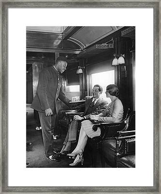 Serving Cocktails On A Train Framed Print by Underwood Archives