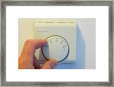 Setting The Central Heating Thermostat Framed Print by Ashley Cooper