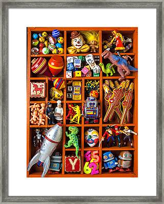 Shadow Box Full Of Toys Framed Print by Garry Gay
