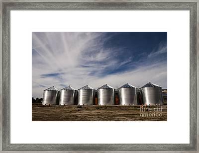 Shiny Silos Framed Print by Juan Romagosa