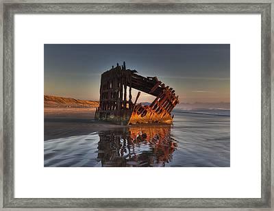 Shipwreck At Sunset Framed Print by Mark Kiver