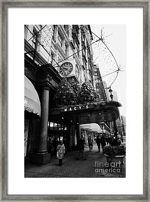 shoppers walk past entrance to Macys department store on Broadway and 34th street at Herald square Framed Print by Joe Fox