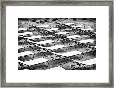 Shore Lounges Framed Print by John Rizzuto